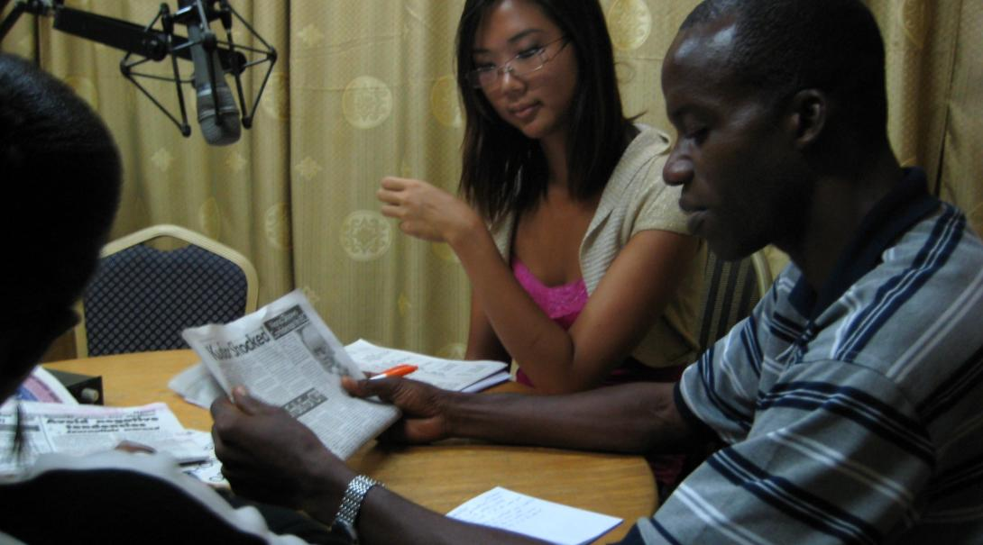 As part of her journalism internship in Ghana with Projects Abroad a volunteer participates in a local radio program.